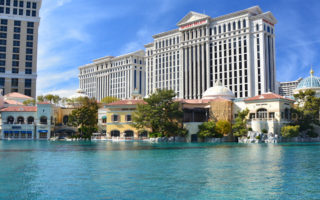 LAS VEGAS, USA - MARCH 18, 2018 : Fountains of Bellagio - Bellagio Hotel & Casino and Caesars Palace in the background.