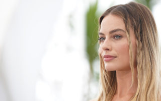 """Margot Robbie attends the photocall for """"Once Upon A Time In Hollywood"""" during the 72nd annual Cannes Film Festival on May 22, 2019 in Cannes, France."""