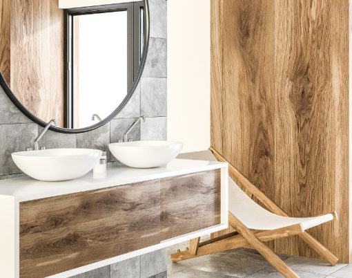 White double sink on wood counter with a round mirror hanging above it in a luxury marble and wooden wall bathroom interior. Spa Hotel. Deck chair 3d rendering