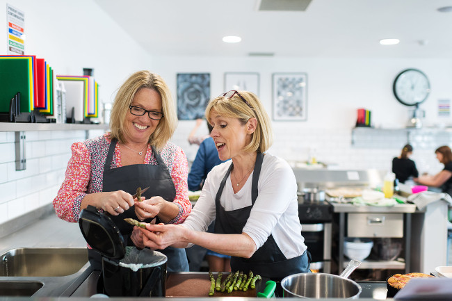 Maria providing personal guidance on a cookery course.