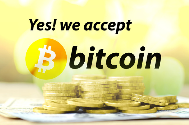 Bitcoin accepted sign with warm light tone and money background in cryptocurrency concept.