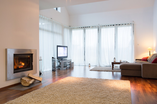 Spacious modern cozy living room with fireplace