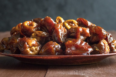 Delicious organic sweet dates in bowl with syrup. Iftar dates.