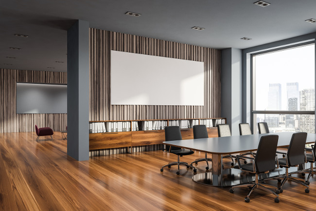 Office waiting room interior with gray and wooden walls, wooden floor, large windows with cityscape and red sofas and armchairs near round coffee tables. Horizontal mock up poster. 3d rendering
