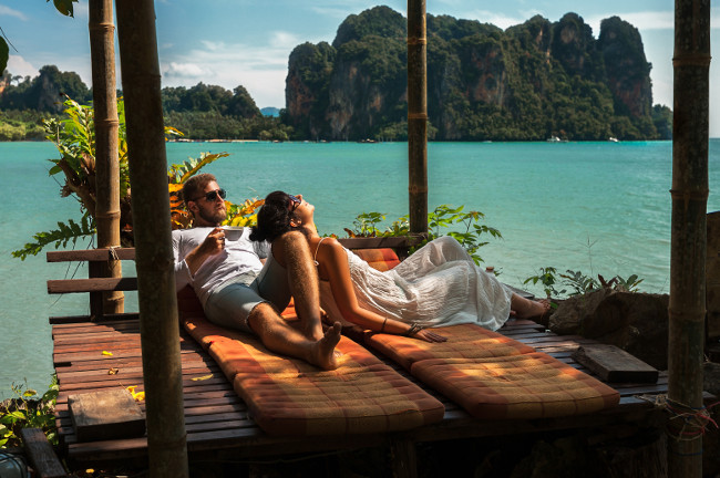 Loving couple resting in Asia. A young couple travels to exotic countries. Man and woman at the resort. Couple resting in Thailand. Honeymoon trip. Wedding travel. Man and woman on the Islands