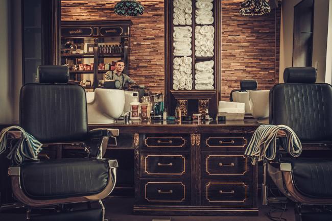 Professional hairstylist in barbershop interior