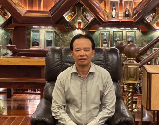 Mr Viet surrounded by his Guinness World Records whisky collection (1)