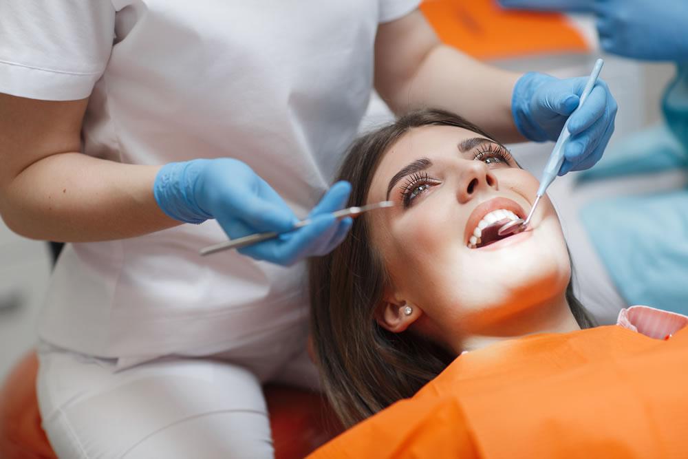 bigstock-Dental-Clinic-Reception-Exam-298903084