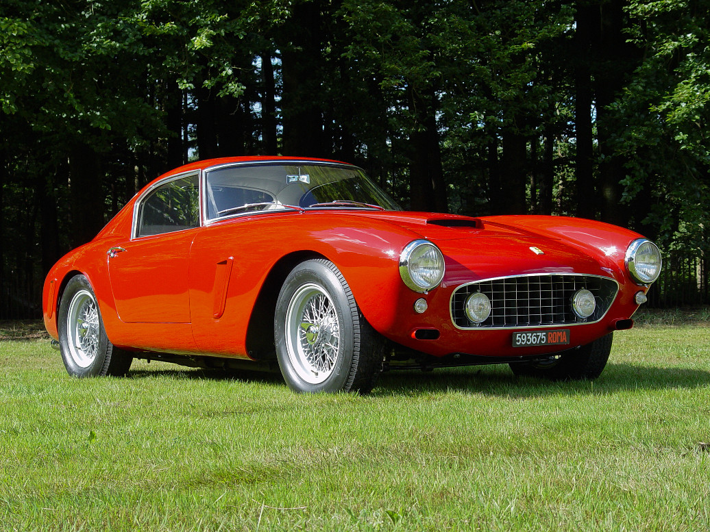 A Ferrari 250 GT SWB on a lawn in the sun during a Councours the Elegance at het Loo, Apeldoorn, the Netherlands. Photo taken at 30-aug-2003