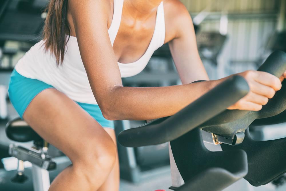 bigstock-Indoor-cycling-woman-doing-HII-216554134