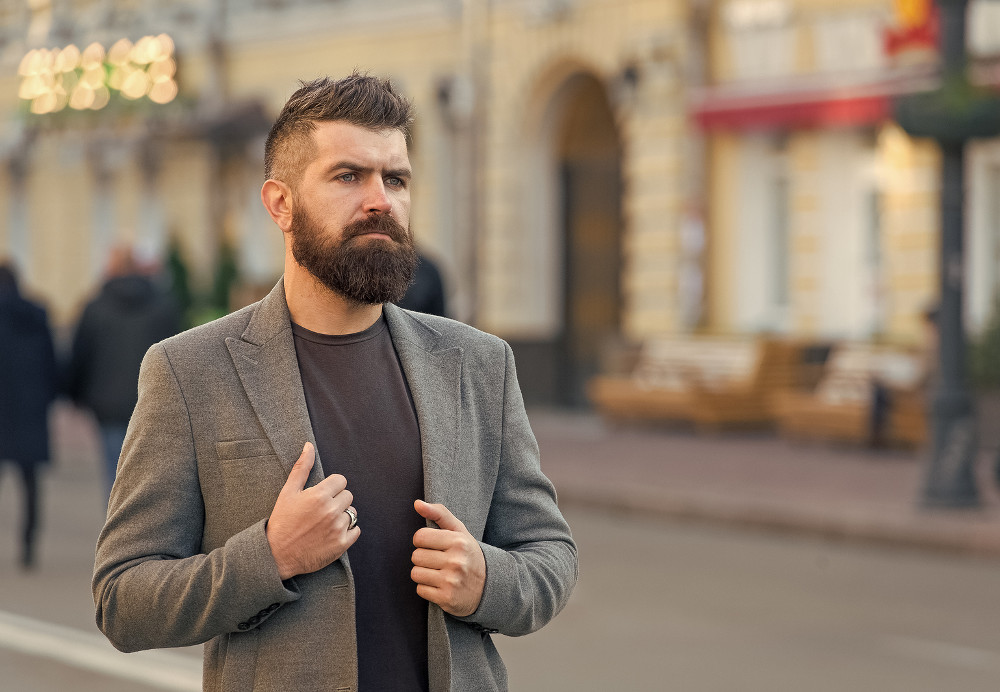 Man bearded hipster stylish fashionable coat. Bearded and cool. Barber tips maintain beard. Hipster appearance. Beard fashion and barber concept. Stylish beard and mustache fall and winter season.