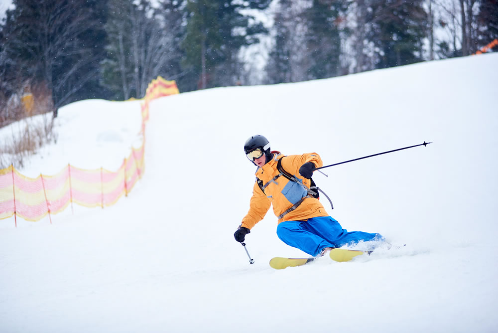 bigstock-Front-View-Of-Young-Skier-Conc-320552185