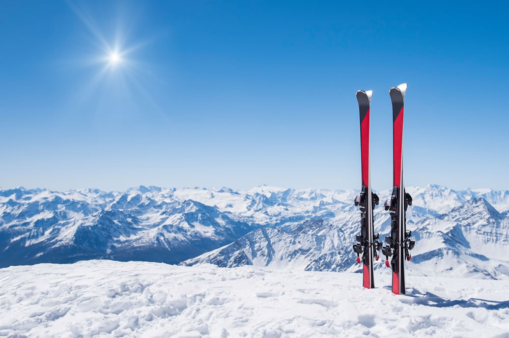 bigstock-Pair-of-skis-in-snow-with-copy-206185990