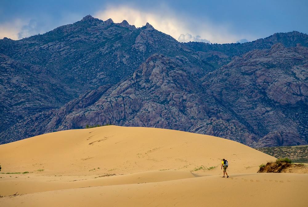 bigstock-The-traveler-in-the-desert-Hi-334227937