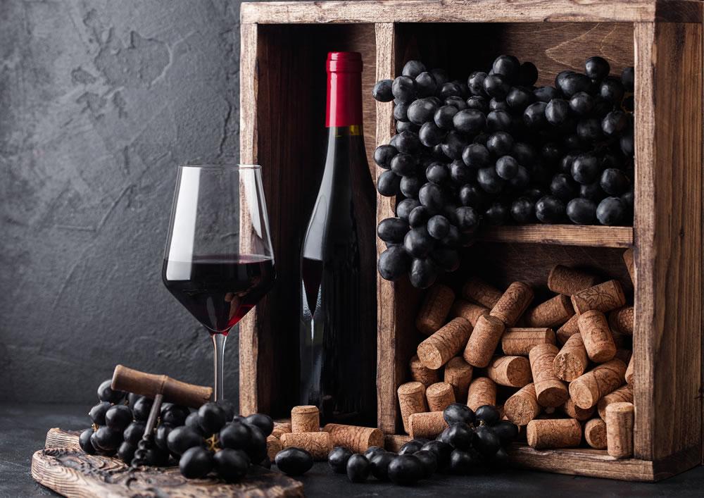 bigstock-Bottle-Of-Red-Wine-With-Dark-G-319895068