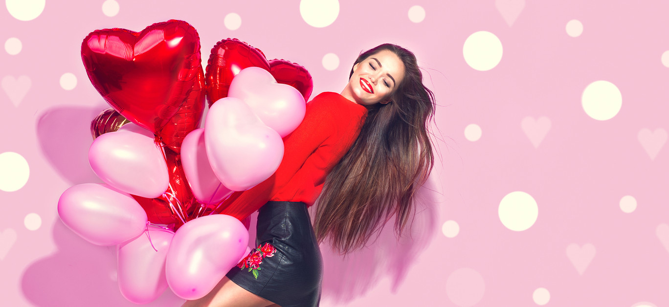 Valentine Beauty girl with red and pink air balloons laughing, o