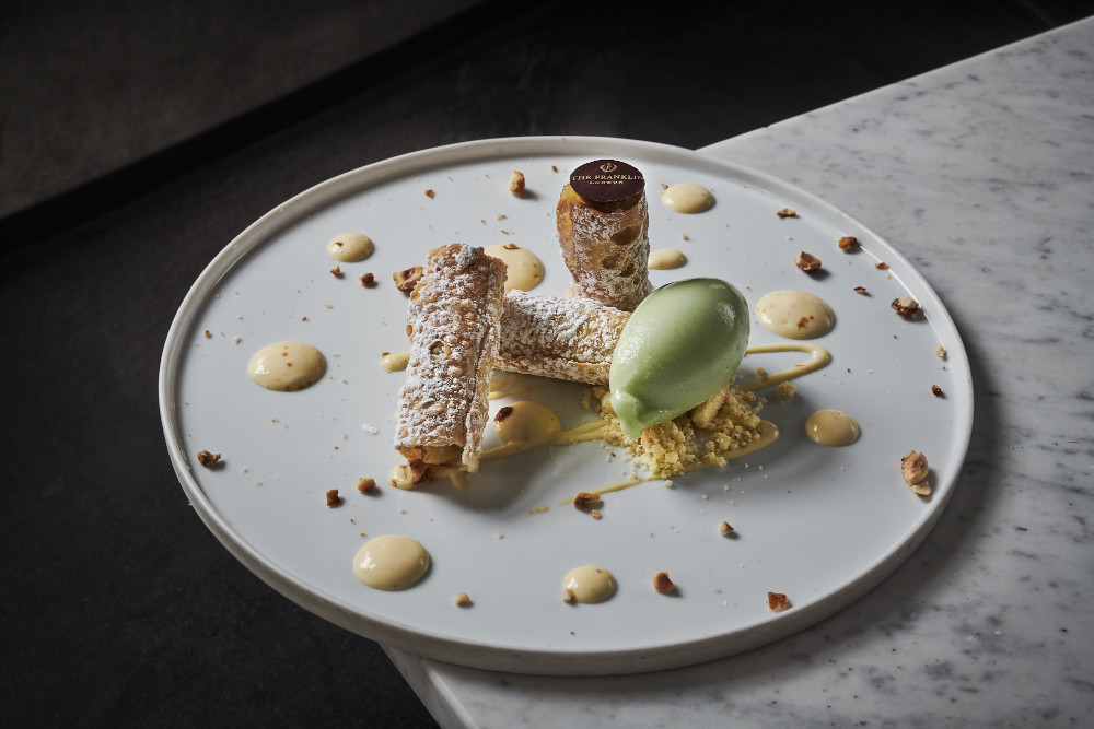 Baked cannoli filled with apple, hazelnut and cinnamon served with granny smith apple sorbet