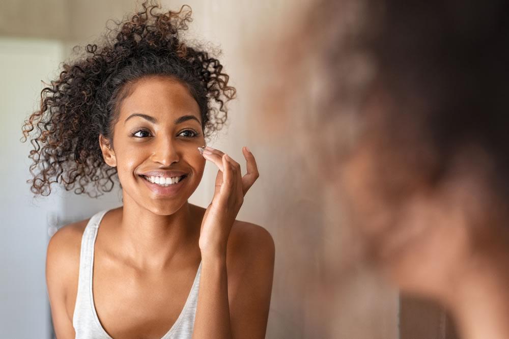 woman applying skincare cream