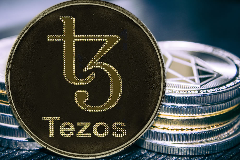 bigstock-Coin-Cryptocurrency-Tezos-On-T-290875486