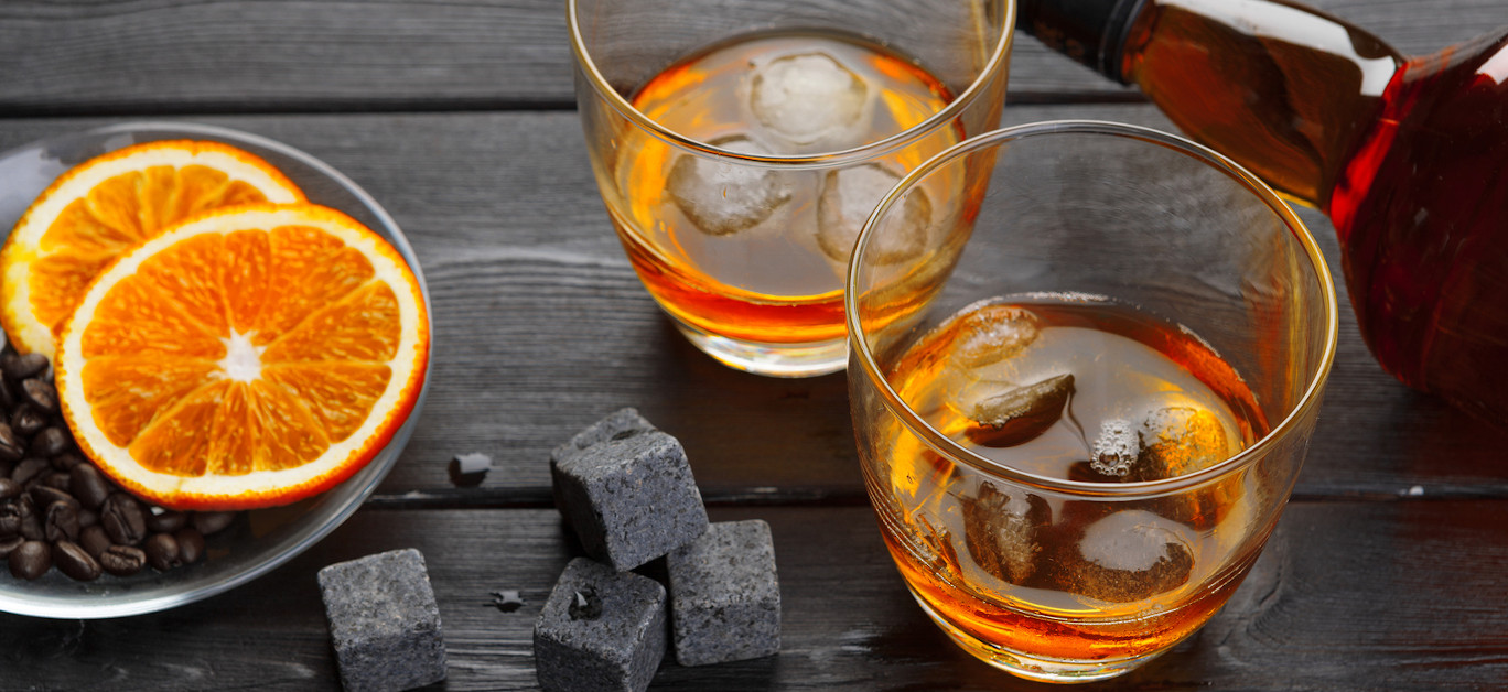Whiskey And Whiskey Stones On A Wooden Table