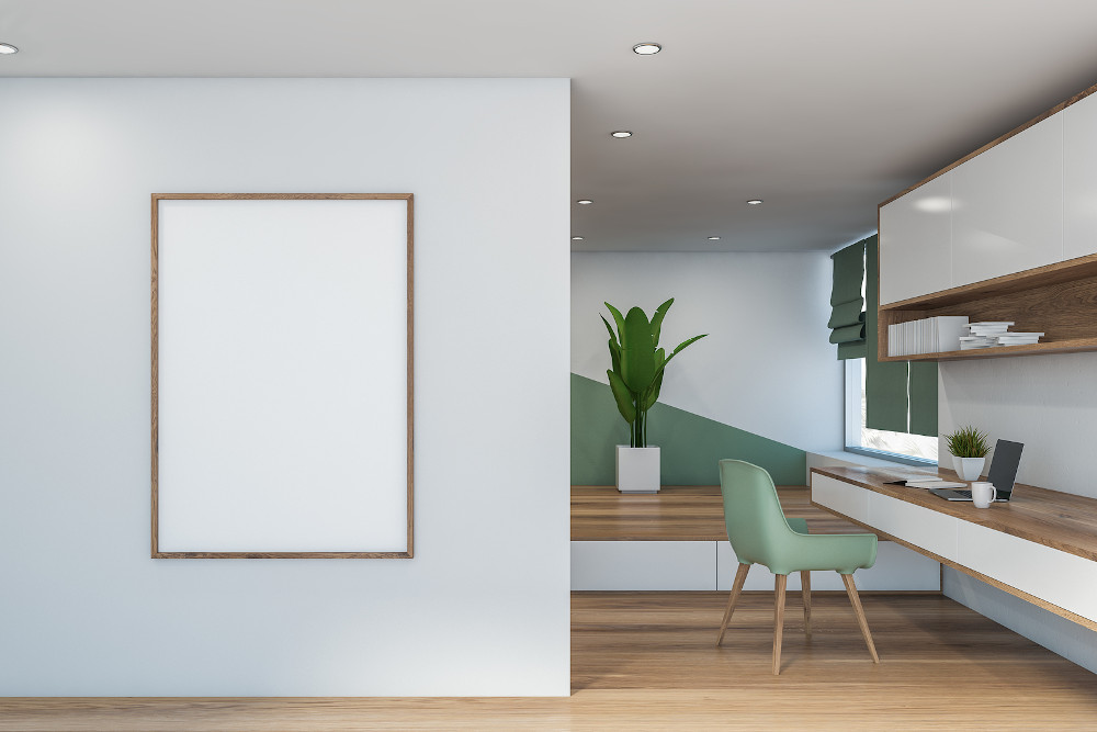 Interior of modern home office with white and green walls, wooden floor, long table with laptop on it, bookcase and green chair near window with blinds. Vertical mock up poster frame. 3d rendering