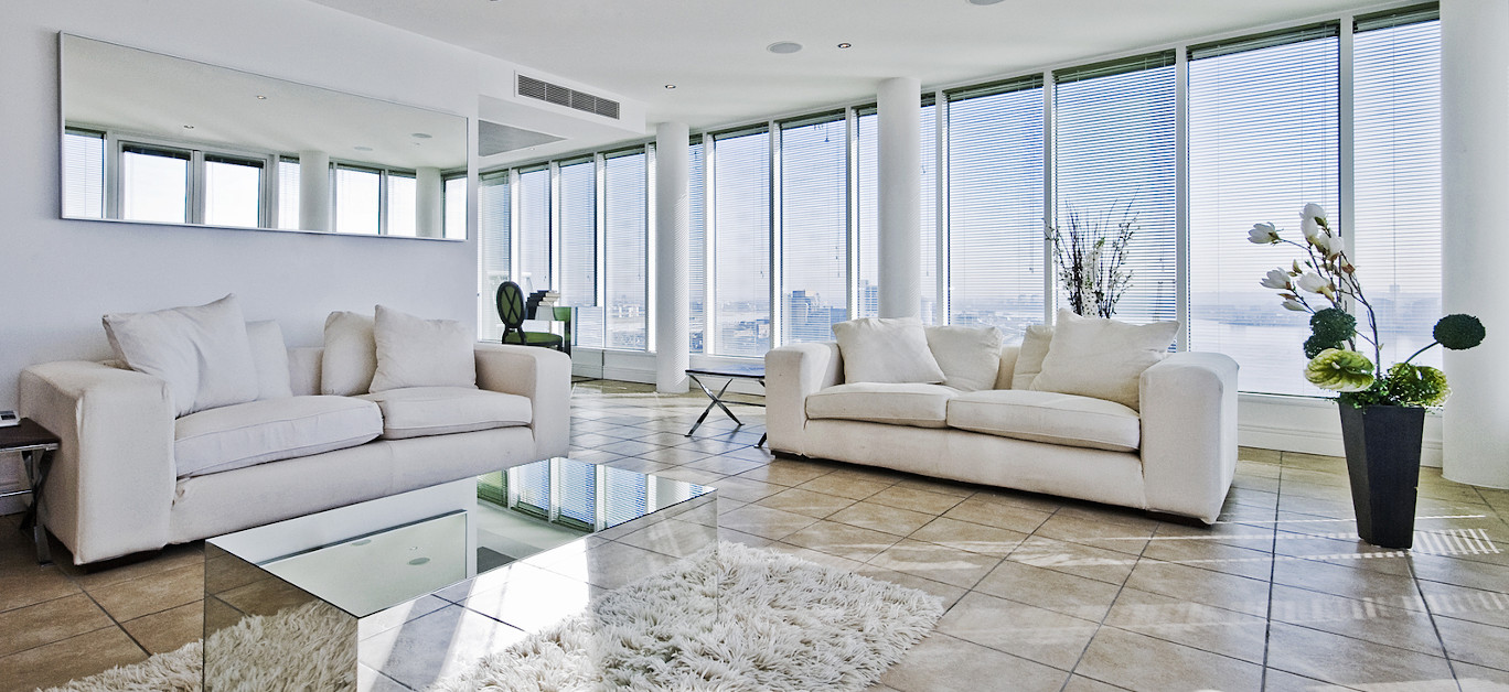 spacious penthouse living room with floor to ceiling windows