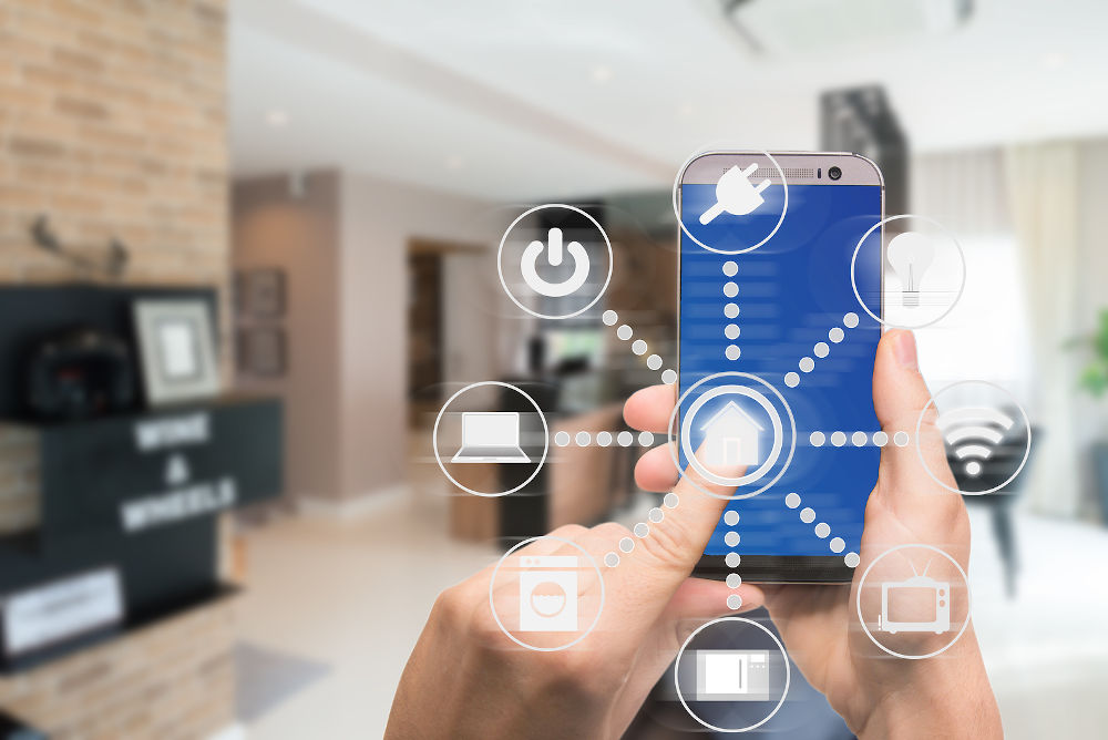 Smart home automation app on mobile with home interior in background. Internet of things concept at home. Smart technology 4.0