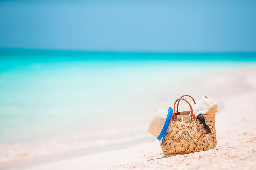 bigstock-Beach-Accessories--Straw-Bag--349727287