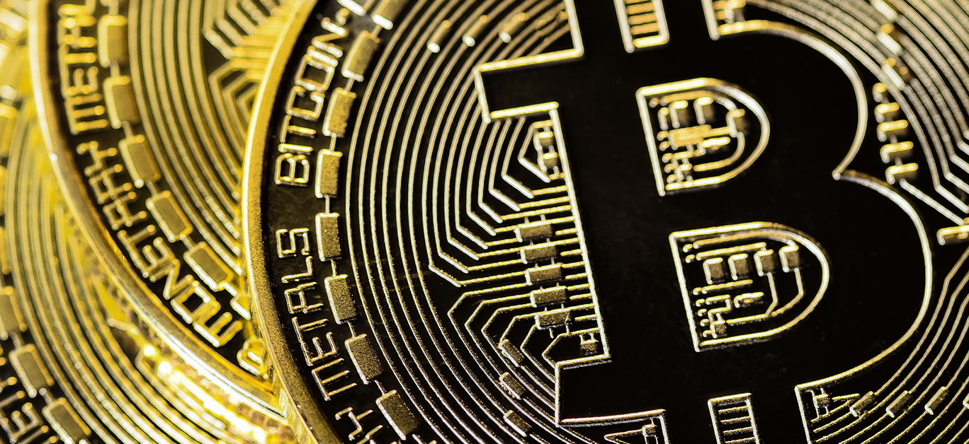 bigstock-Crypto-Currency-Closeup-Golden-366620485