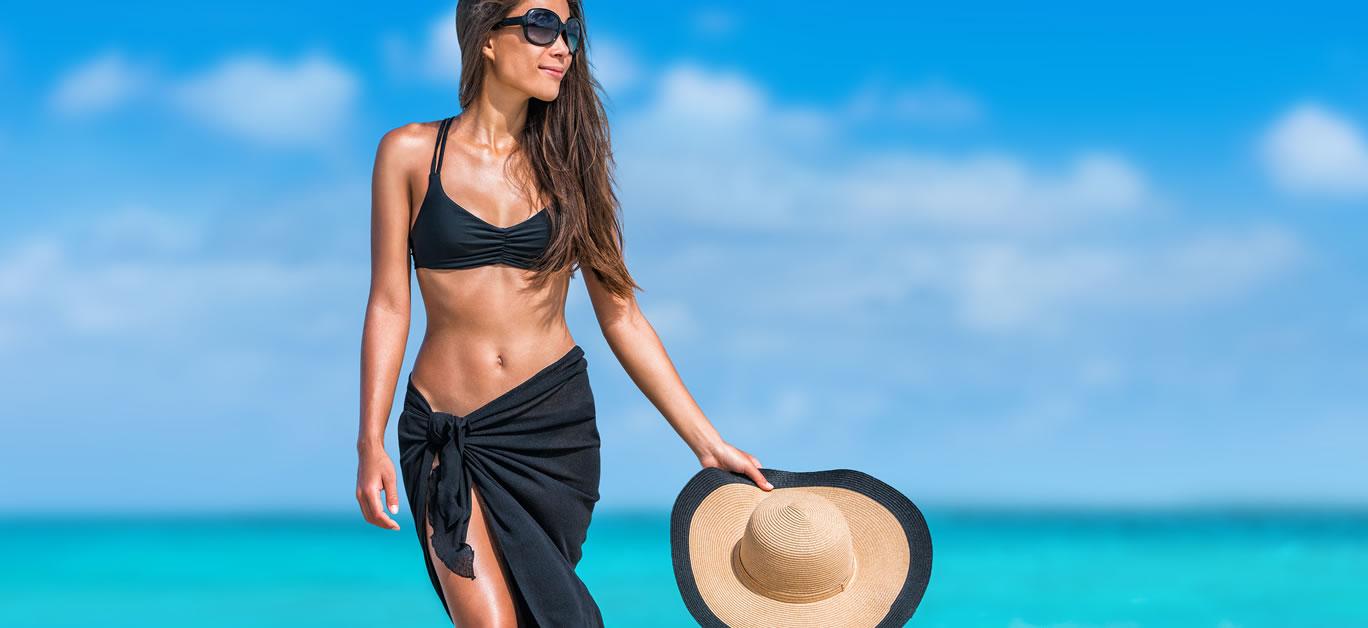 bigstock-Elegant-beach-woman-in-bikini--128219867