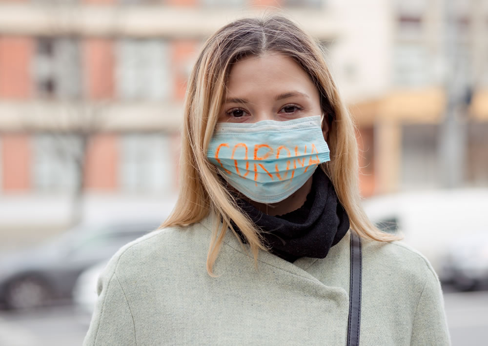 bigstock-Girl-With-Mask-To-Protect-Her--355223594