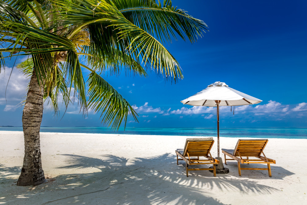 Maldives beach with luxurious water villas and loungers beautiful tropical