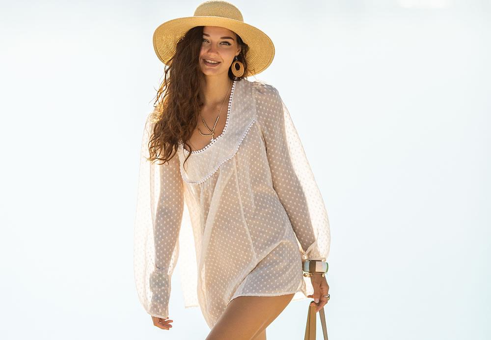 bigstock-Romantic-Woman-Walking-On-A-Be-362598340