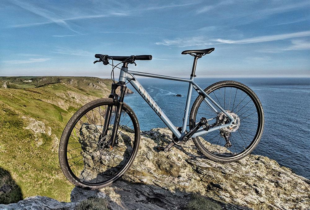 canyon pathlite hybrid bike on coastal path