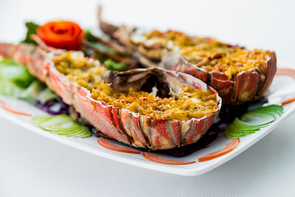 bigstock-Cooked-Lobster-With-Vegetables-366716239