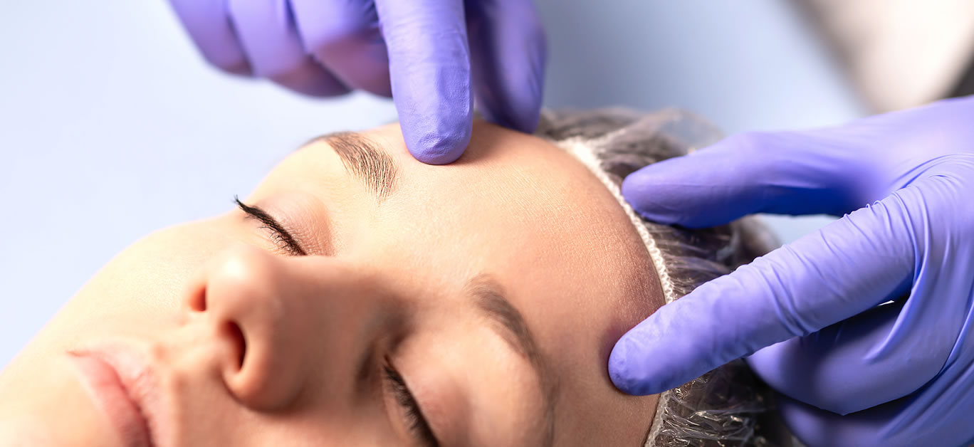 bigstock-Cosmetologist-Plastic-Surgeon-308670874