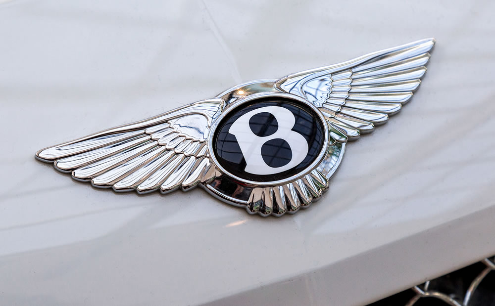 """Bentley logo """"Flying B"""" on the car. Bentley Motors Limited is a British manufacturer of luxury automobiles"""