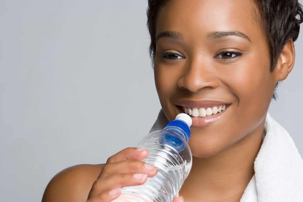 bigstock-Healthy-Woman-Drinking-Water-12039779