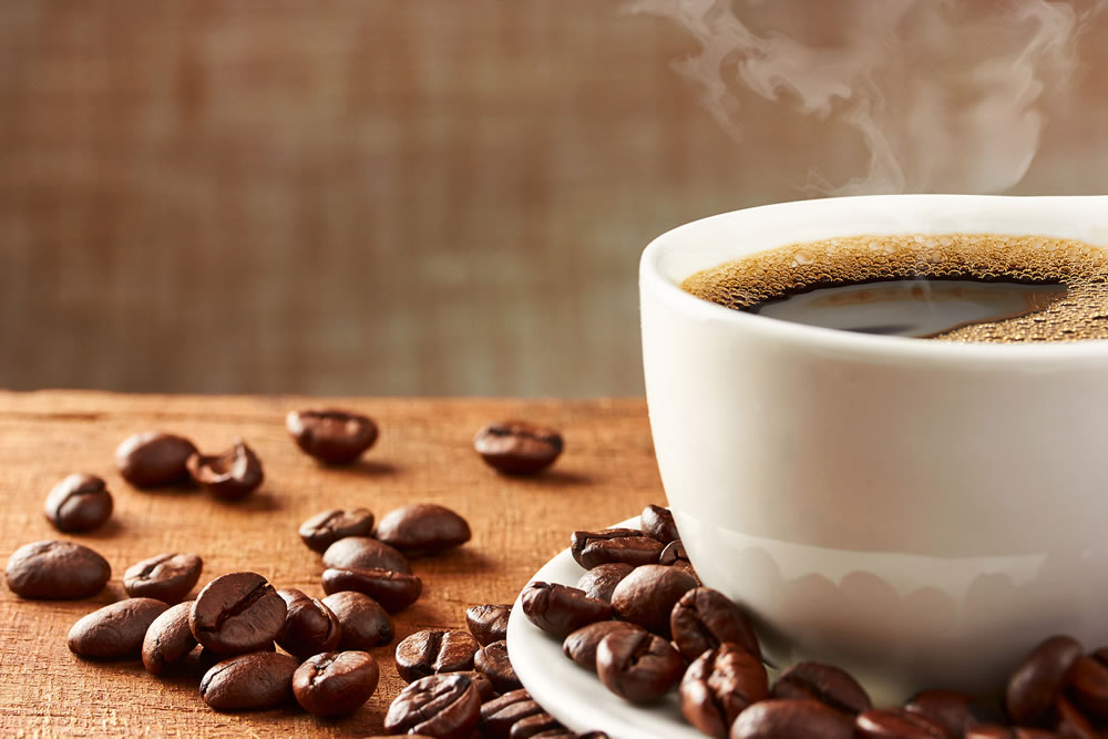 bigstock-Coffee-Cup-And-Coffee-Beans-84244856