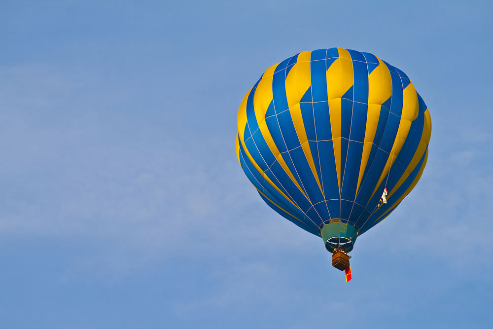 bigstock-Hot-Air-Balloon-In-Cloudy-Sky-17482655