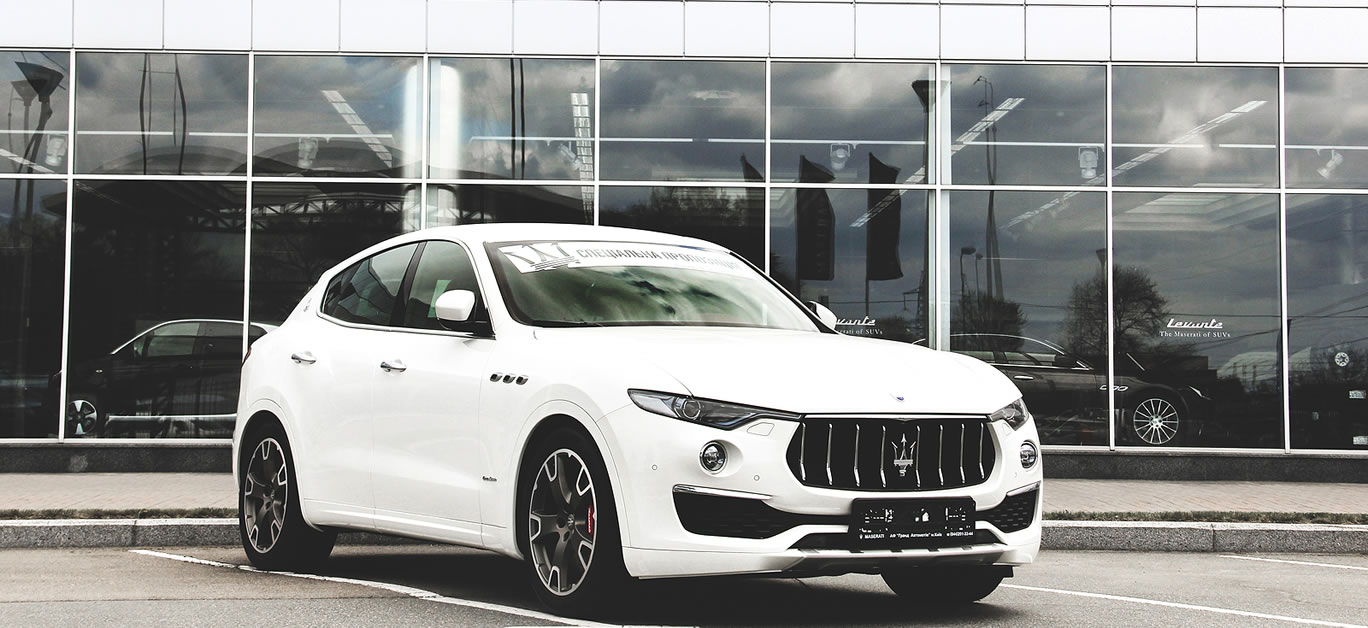 A luxury Maserati Levante car parked in the city. Car for sale. Wallpaper