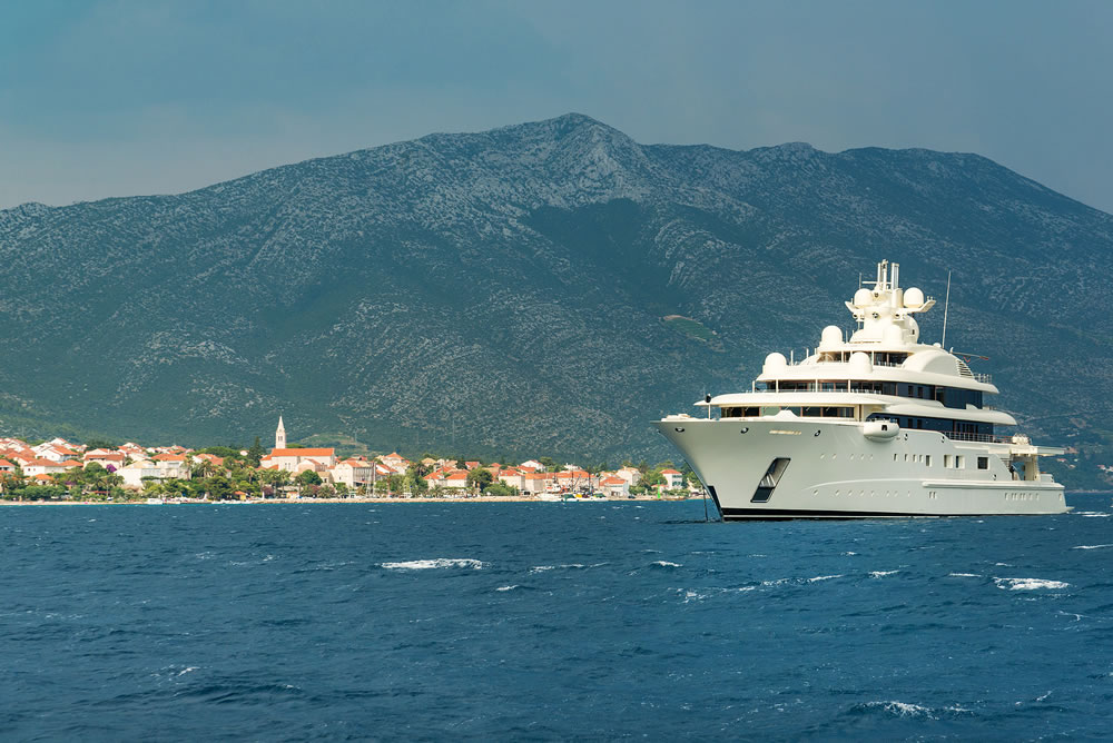 bigstock-Luxury-Super-Yacht-Passing-Kor-372162988