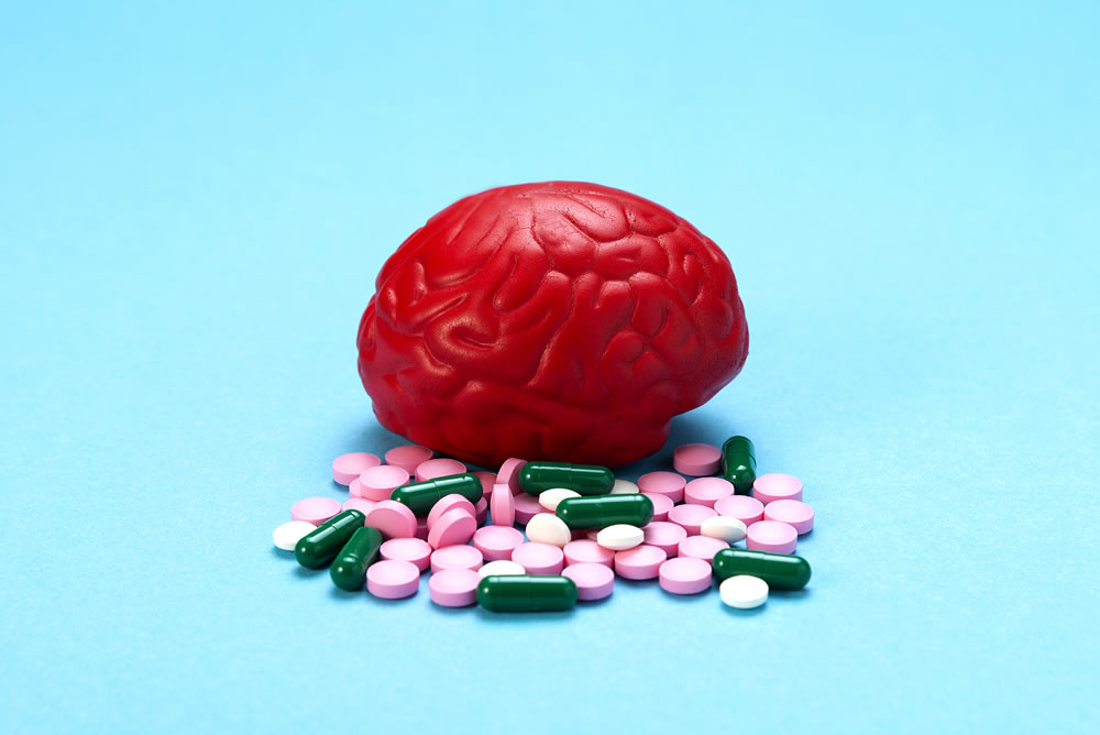 bigstock-Red-Brain-On-A-Blue-Background-307660873