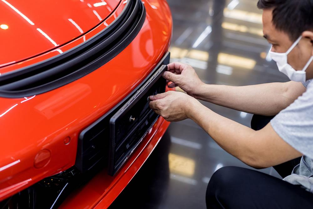 bigstock-Technician-Changing-Car-Plate--371321137