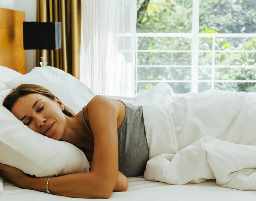 bigstock-Woman-sleeping-on-bed-in-luxur-285257629