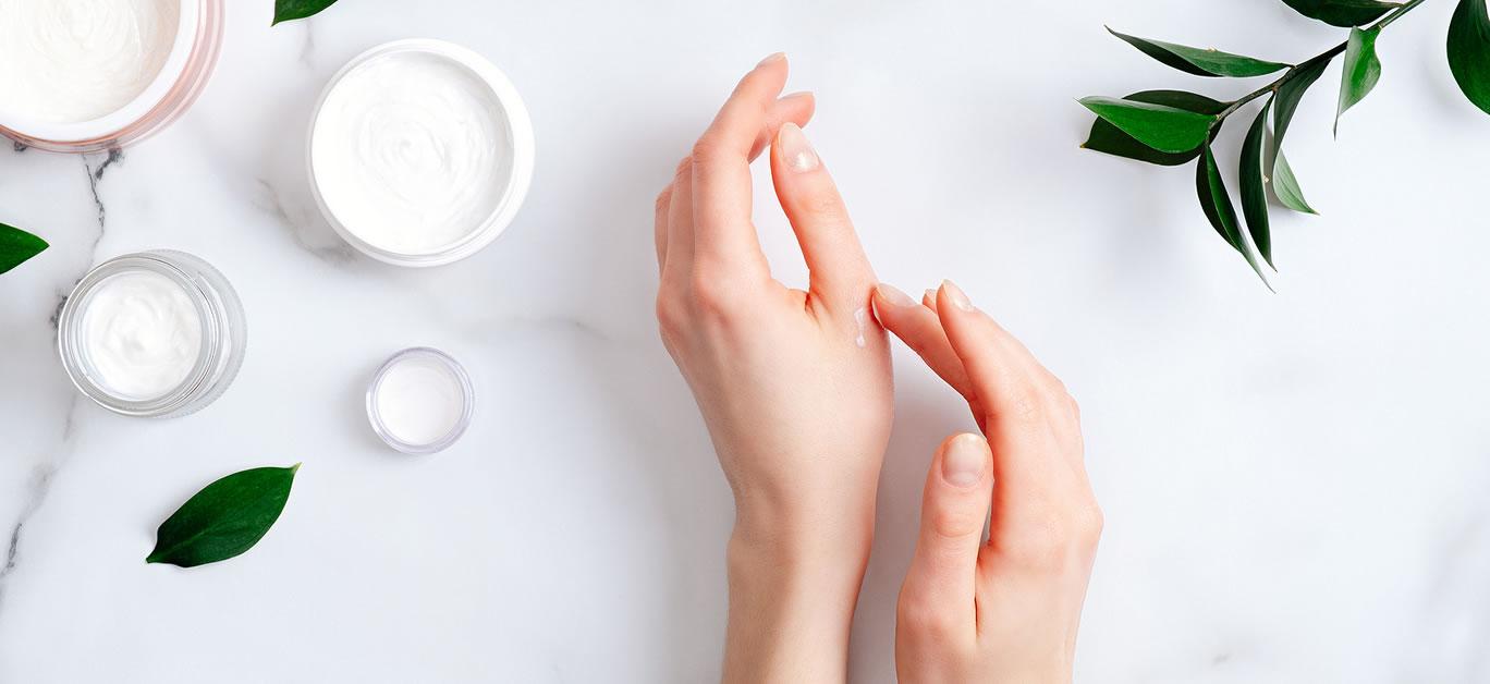 bigstock-Cosmetic-Cream-On-Female-Hands-345266005