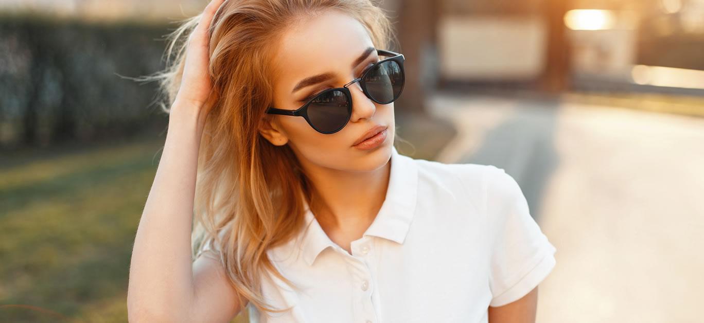 bigstock-Beautiful-Young-Woman-In-Sungl-181401997