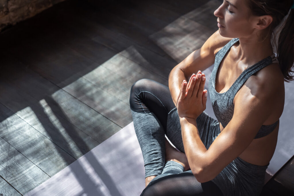 mindful woman sit in lotus pose doing yoga exercise