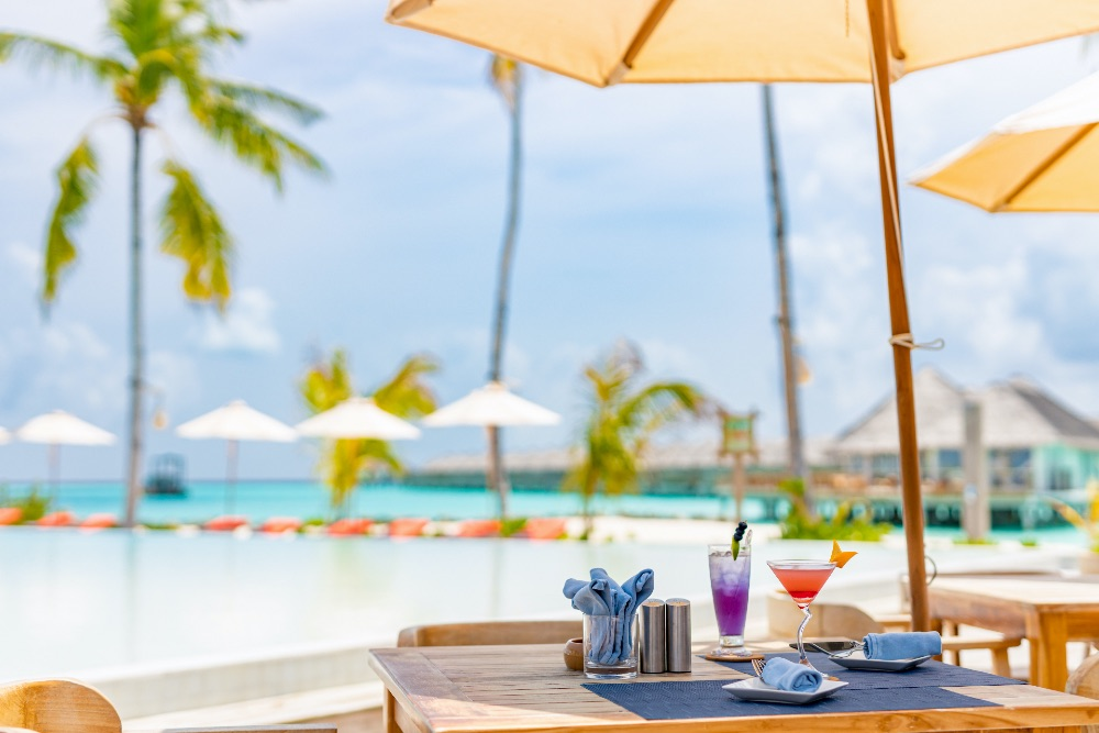 Table set up next to a pool overlooking the sea