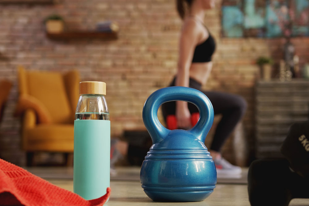 Fitness equipment and woman exercising